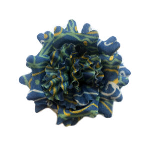 Blue lapel flower with white and green abstract pattern