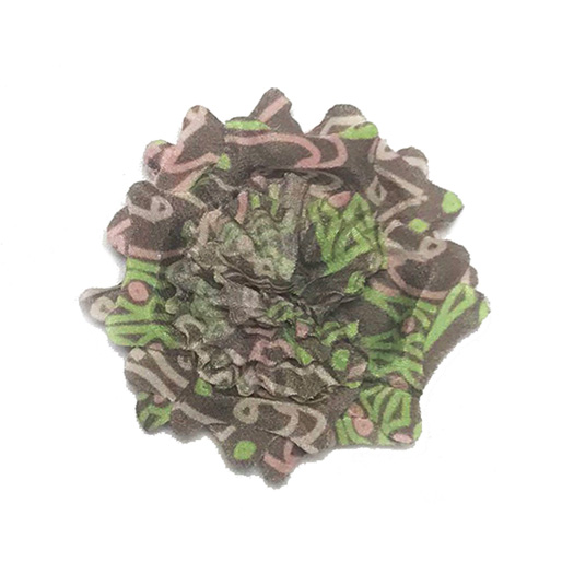 Light brown lapel flower with green and pink abstract pattern