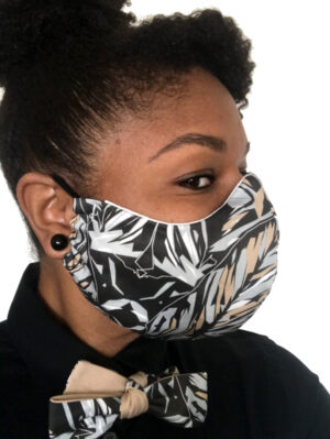woman in black floral print mask side view