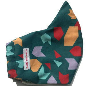 profile of evergreen curved face mask with red, teal and purple print