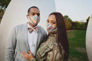 Couple wearing multi color bias stripe face masks