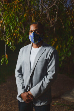 man wearing blue curved mask with yellow tile accents